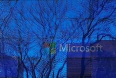 An advertisement is played on a set of large screens at the Microsoft office in Cambridge, Massachusetts, U.S. January 25, 2017.   REUTERS/Brian Snyder