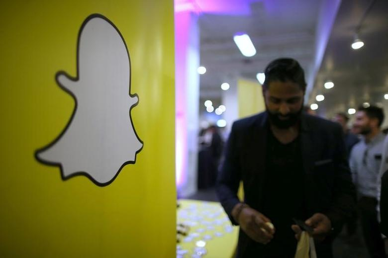 The logo of messaging app Snapchat is seen at a booth at TechFair LA, a technology job fair, in Los Angeles, California, U.S., January 26, 2017. REUTERS/Lucy Nicholson
