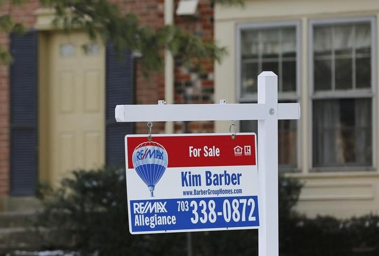 A townhouse for sale sign hangs in front of a house in Oakton, Virginia, on the day the National Association of Realtors issues its Pending Home Sales for February report, in Virginia March 27, 2014.  REUTERS/Larry Downing