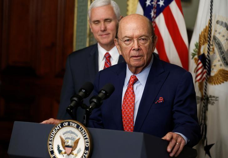Wilbur Ross speaks, as U.S. Vice President Mike Pence watches, after being sworn in as Secretary of Commerce in Washington, DC, U.S. February 28, 2017. REUTERS/Joshua Roberts