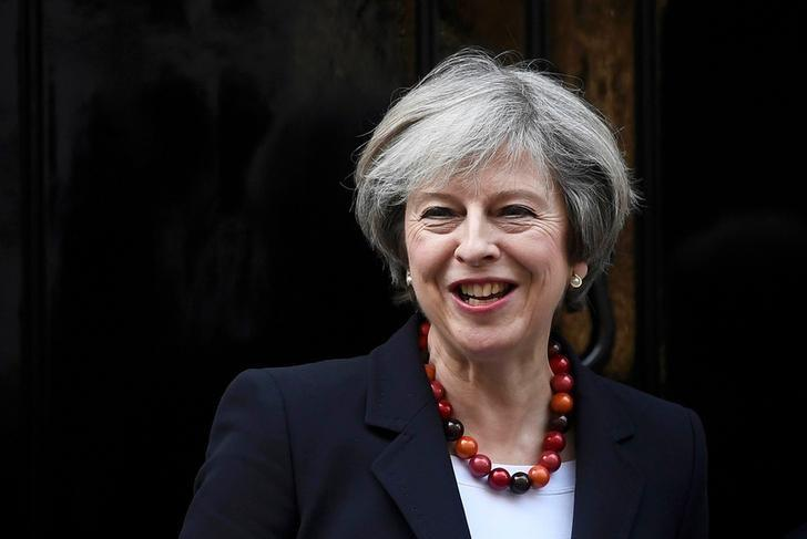 British Prime Minister Theresa May smiles as she greets her French counterpart Bernard Cazeneuve at Number 10 Downing Street in London, Britain, February 17, 2017. REUTERS/Toby Melville/File Photo