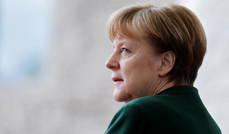 German Chancellor Angela Merkel awaits the arrival of the new European Parliament President Antonio Tajani at the Chancellery in Berlin, Germany, February 24, 2017. REUTERS/Hannibal Hanschke/Files