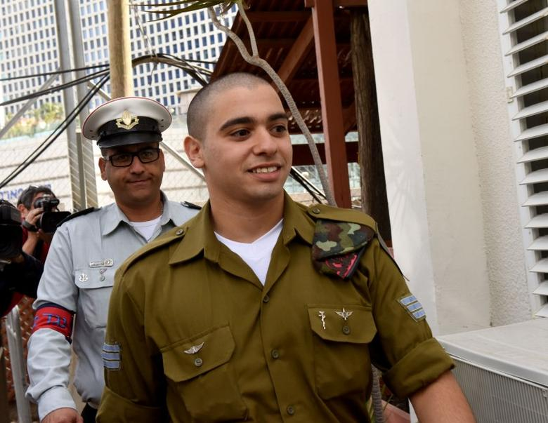 Israeli soldier Elor Azaria (R), convicted of manslaughter, arrives to a military court where arguments for his sentencing will be heard in Tel Aviv January 24, 2017. REUTERS/Debbie Hill/Pool