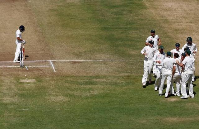 Australia's players celebrate the wicket of India's captain Virat Kohli. REUTERS/Danish Siddiqui