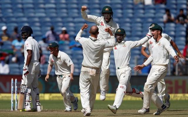 Australia's players celebrate after winning the match. REUTERS/Danish Siddiqui