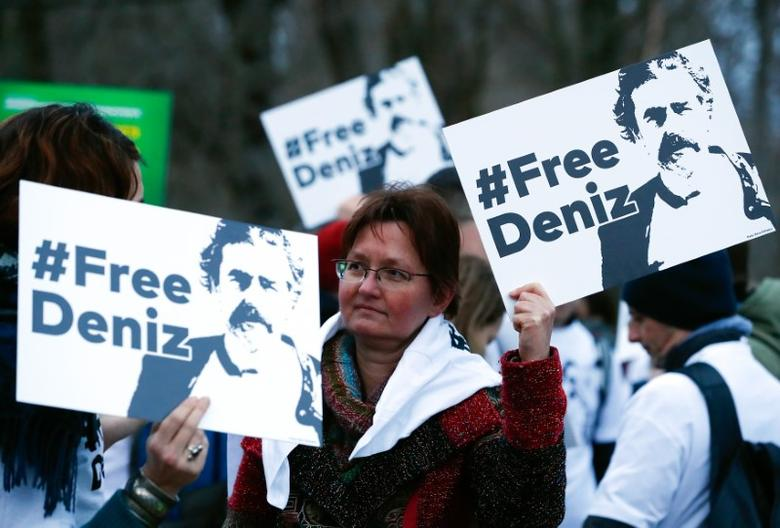 Protestors carry placards during a demonstration to support arrested German-Turkish journalist Deniz Yucel outside theTurkish Embassy in Berlin, Germany, February 28, 2017.     REUTERS/Fabrizio Bensch