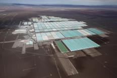 An aerial view shows the brine pools and processing areas of the Soquimich (SQM) lithium mine on the Atacama salt flat, the world's second largest salt flat and the largest lithium deposit currently in production, with over a quarter of the world's known reserves, in the Atacama desert of northern Chile, January 10, 2013. SQM fertilizer company has fired its chief executive after it became embroiled in an election campaign financing scandal that has rocked the Chilean establishment, tainting business leaders and politicians with close links to the 1973-1990 dictatorship of Augusto Pinochet. Picture taken January 10, 2013. REUTERS/Ivan Alvarado (CHILE - Tags: SOCIETY BUSINESS ENVIRONMENT POLITICS) - RTR4TQD2