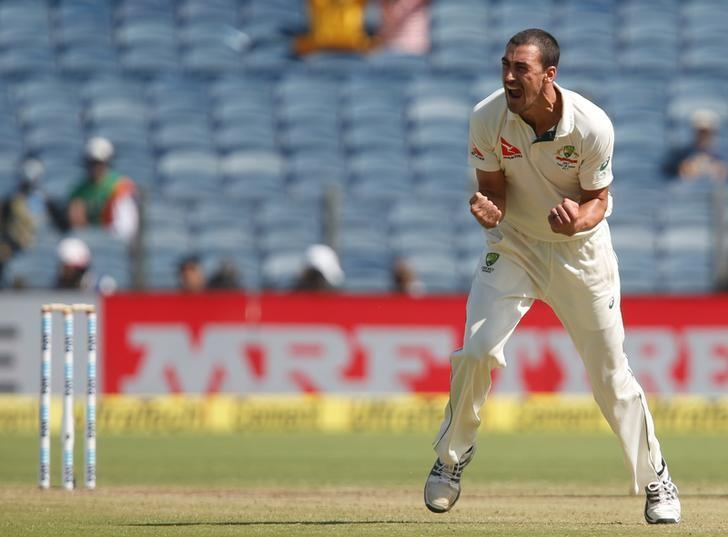 Cricket - India v Australia - First Test cricket match - Maharashtra Cricket Association Stadium, Pune, India - 24/02/17. Australia's Mitchell Starc celebrates the wicket of India's captain Virat Kohli. REUTERS/Danish Siddiqui
