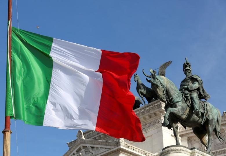 The Italian flag waves in front of The ''Altare della Patria'' also known as ''Vittoriano'' downtown Rome, Italy, March 23, 2016.  REUTERS/Stefano Rellandini