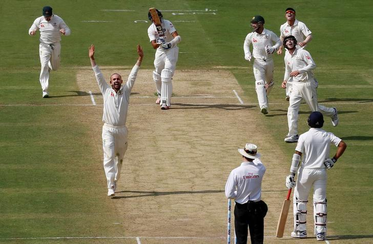 Cricket - India v Australia - Second Test cricket match - M Chinnaswamy Stadium, Bengaluru, India - 04/03/17. Australia's Nathan Lyon celebrates the wicket of India's Ishant Sharma with his teammates. REUTERS/Danish Siddiqui
