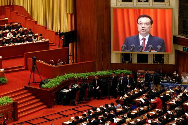 A screen shows China's Premier Li Keqiang delivering a government work report during the opening session of the National People's Congress (NPC) at the Great Hall of the People in Beijing, China, March 5, 2017. REUTERS/Damir Sagolj