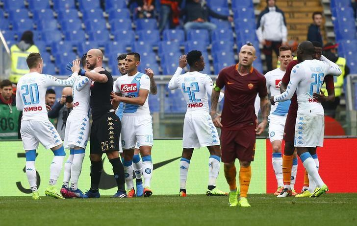 Football Soccer - AS Roma v Napoli - Italian Serie A - Olympic stadium, Rome, Italy - 04/03/17 - Napoli's players celebrate at the end of the match against AS Roma.  REUTERS/Tony Gentile