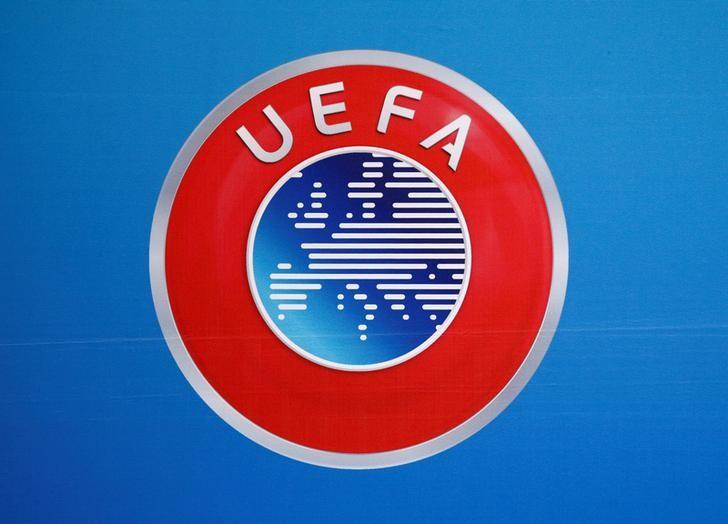 A logo is pictured on a backdrop before a news conference after an UEFA Executive Board meeting in Nyon, Switzerland, December 9, 2016. REUTERS/Denis Balibouse/Files