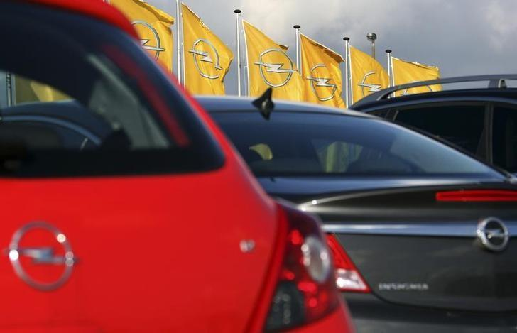 Flags with the Opel company logo wave outside the automaker's assembly plant in Antwerp November 4, 2009. REUTERS/Thierry Roge/Files