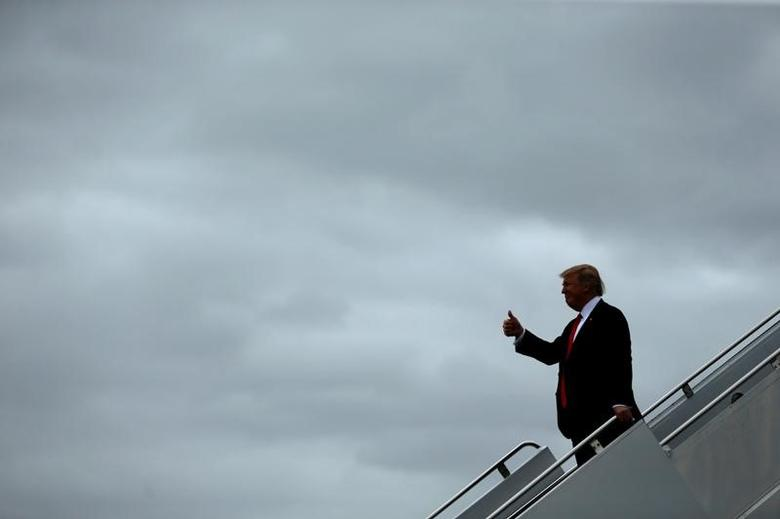 U.S. President Donald Trump arrives aboard Air Force One at Palm Beach International Airport in West Palm Beach, Florida, U.S. March 3, 2017. REUTERS/Jonathan Ernst