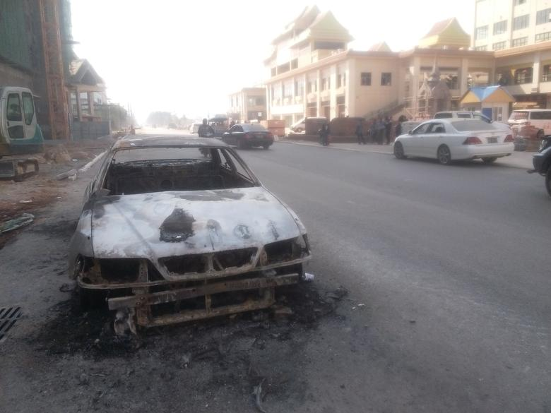 A burnt car is seen after fighters of the Chinese Myanmar National Democratic Alliance Army (MNDAA) launched an attack on March 6 on police, military and government sites in Laukkai, Myanmar March 7, 2017. REUTERS/Stringer