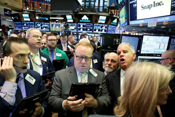 Traders gather on the floor for the IPO of Snap Inc. at the New York Stock Exchange (NYSE) in New York, U.S., March 2, 2017. REUTERS/Brendan McDermid