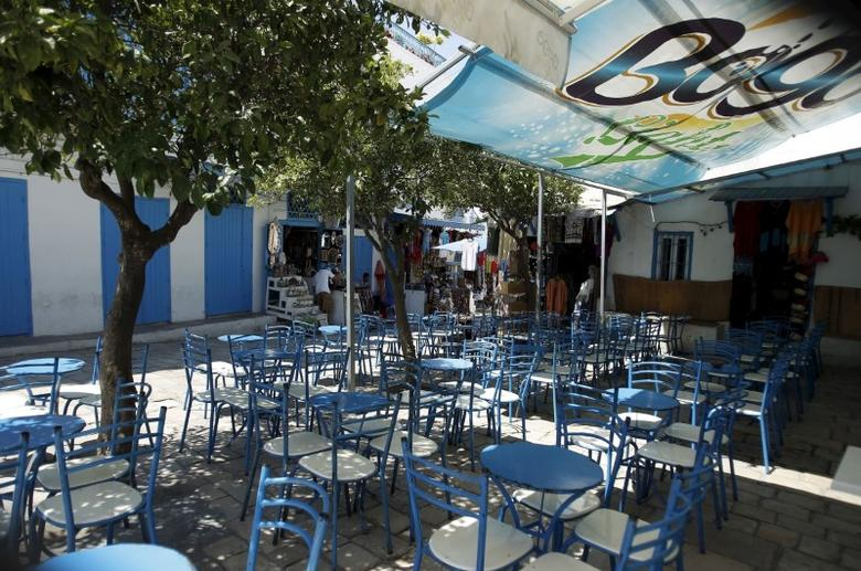 Empty tables are seen at the terrace of a coffee shop in Sidi Bou Said, a popular tourist destination near Tunis, Tunisia July 7, 2015. REUTERS/Zoubeir Souissi