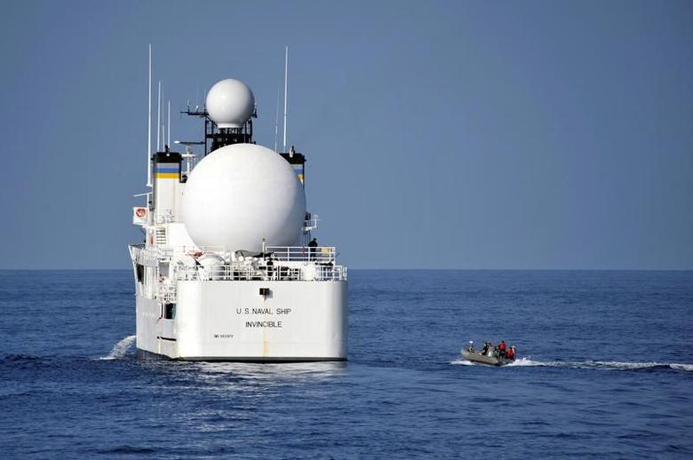 U.S. sailors in a rigid-hull inflatable boat approach the Military Sealift Command missile range instrumentation ship USNS Invincible (L) to conduct a personnel transfer in Arabian Sea on November 21, 2012.  Deven B. King/U.S. Navy/Handout via REUTERS