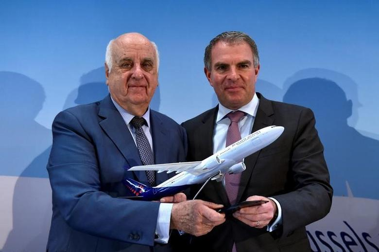 (L to R) SN Airholding Chairman Etienne Davignon and Lufthansa CEO Carsten Spohr pose for the photographers as they hold a Brussels Airlines model airplane after a news conference on the Lufthansa deal to fully take over Brussels Airlines in Zaventem, Belgium December 15, 2016. REUTERS/Eric Vidal
