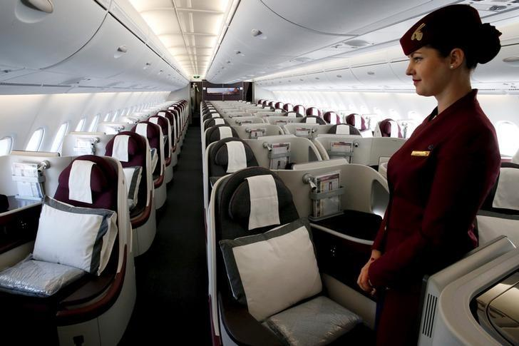 A Qatar Airways crew member presents the business class seats of an Airbus A380 aircraft during the 51st Paris Air Show at Le Bourget airport near Paris June 17, 2015. REUTERS/Pascal Rossignol