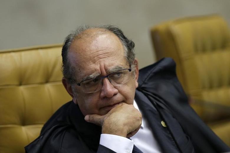 Judge Gilmar Mendes reacts during a session at the Supreme Court in Brasilia March 11, 2015. REUTERS/Ueslei Marcelino