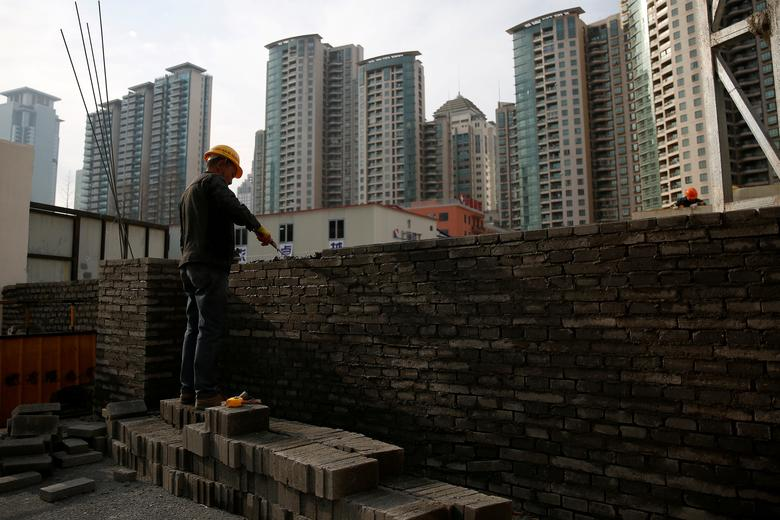 FILE PHOTO: A worker works at a construction site in Shanghai, China March 3, 2017. REUTERS/Aly Song/File Photo