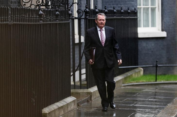 Britain's Secretary of State for International Trade and President of the Board of Trade Liam Fox leaves 10 Downing Street after a cabinet meeting ahead of the budget in London, March 8, 2017. REUTERS/Stefan Wermuth