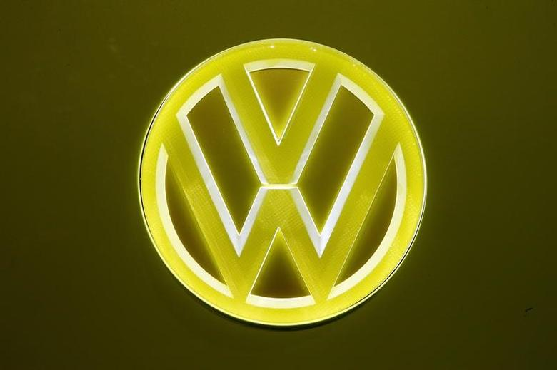 An illuminated logo is seen at a Volkswagen I.D. Buzz concept car during the 87th International Motor Show at Palexpo in Geneva Switzerland March 8, 2017. REUTERS/Arnd Wiegmann