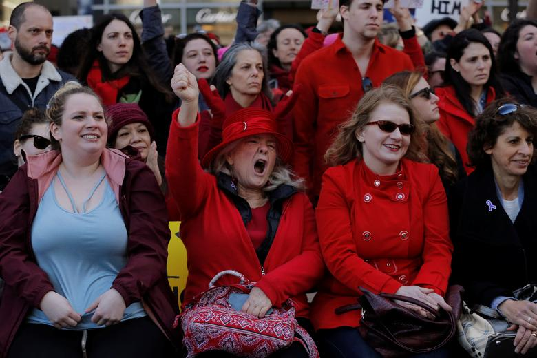 Women take part in a 'Day Without a Woman' march on International Women's Day in New York. REUTERS/Lucas Jackson