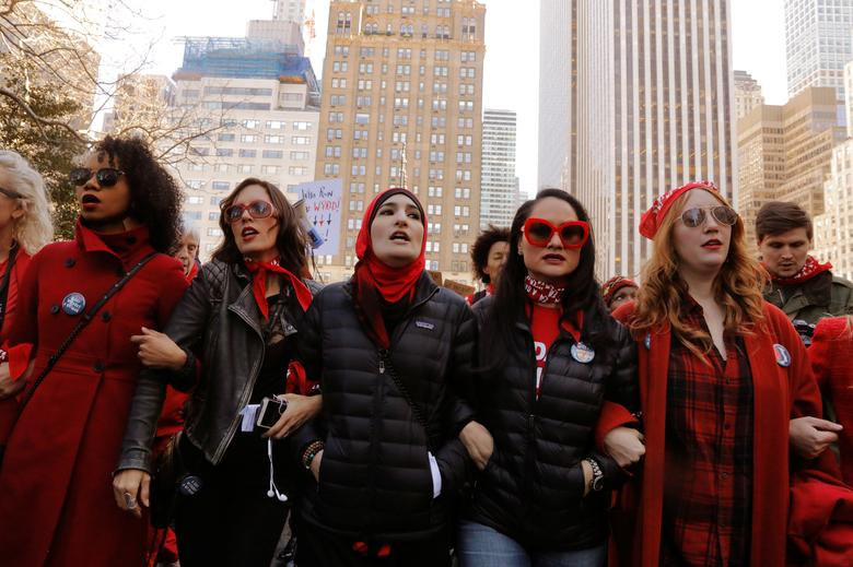 Organizers Linda Sarsour (C), Carmen Perez (2nd R) and Bob Bland (R) lead during a 'Day Without a Woman' march on International Women's Day in New York. REUTERS/Lucas Jackson