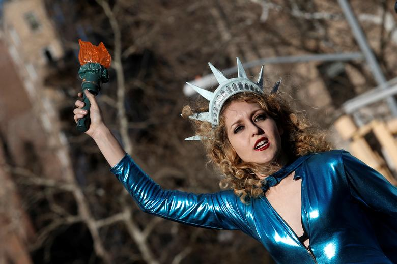 Sonia Sheron performs on stage during a rally and march on International Women's Day in Washington Square Park in Manhattan, New York. REUTERS/Mike Segar