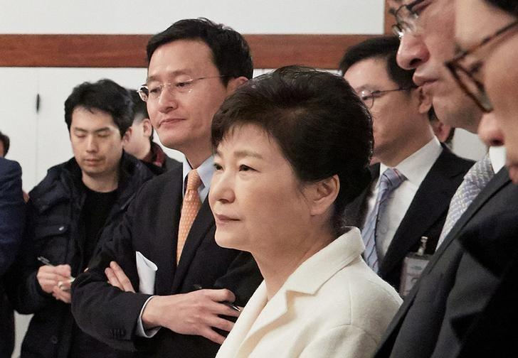 South Korean President Park Geun-hye listens to a reporter's question during a meeting with reporters at the Presidential Blue House in Seoul, South Korea, in this handout picture provided by the Presidential Blue House and released by Yonhap on January 1, 2017.    Blue House/Yonhap via REUTERS/Files