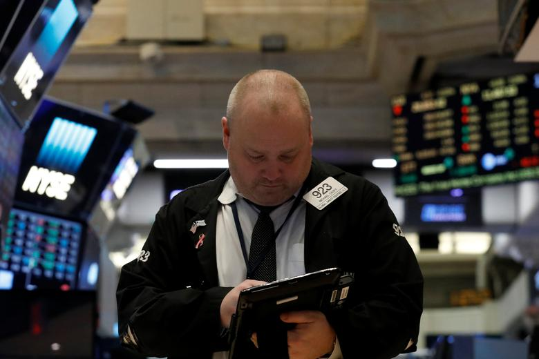 A trader works on the floor of the New York Stock Exchange (NYSE) in New York, U.S., March 10, 2017. REUTERS/Brendan McDermid
