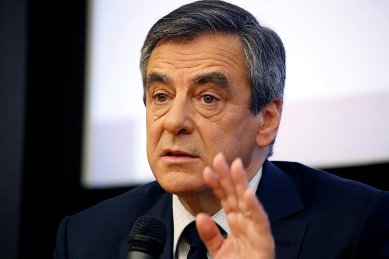 Francois Fillon, former French Prime Minister, member of the Republicans political party and 2017 presidential election candidate of the French centre-right, attends a meeting at the National Assembly in Paris, France, March 8, 2017.  REUTERS/Charles Platiau