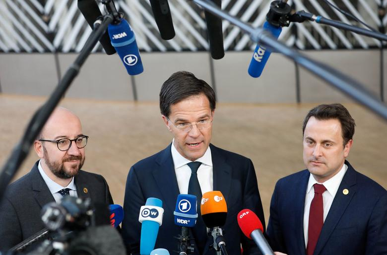 Belgium's Prime Minister Charles Michel, Netherlands Prime Minister Mark Rutte and Luxembourg's Prime Minister Xavier Bettel (L-R) arrive together at a European Union leaders' summit in Brussels, Belgium March 10, 2017. REUTERS/Yves Herman