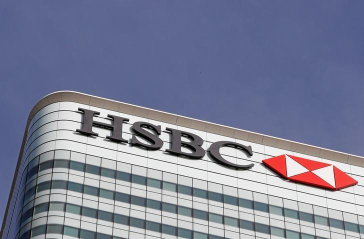FILE PHOTO - The HSBC bank logo is seen at their offices in the Canary Wharf financial district in London, Britain, March 3, 2016.  REUTERS/Reinhard Krause/File Photo