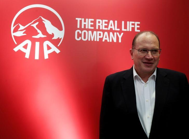 FILE PHOTO: AIA Group Chief Executive and President Mark Tucker poses during a news conference on the company's annual results in Hong Kong, China February 24, 2017.      REUTERS/Bobby Yip/File photo