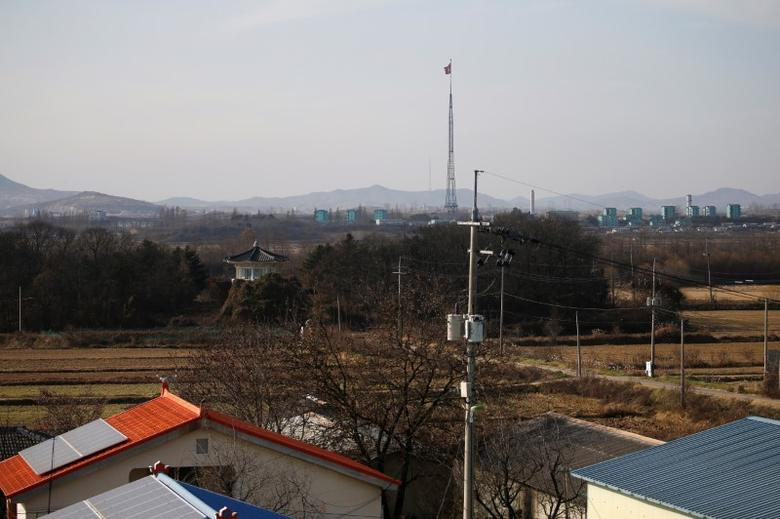 North Korean flag flatters on the top of 160-metre tower at North Korea's propaganda village of Gijungdong in this picture taken from the Tae Sung freedom village near the Military Demarcation Line (MDL), inside the demilitarised zone separating the two Koreas, in Paju, South Korea, November 22, 2016.  REUTERS/Kim Hong-Ji