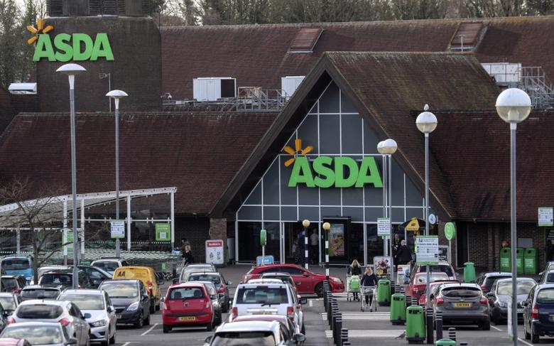 Shoppers leave the Asda superstore in High Wycombe, Britain, February 7, 2017.  Picture taken February 7, 2017. REUTERS/Eddie Keogh