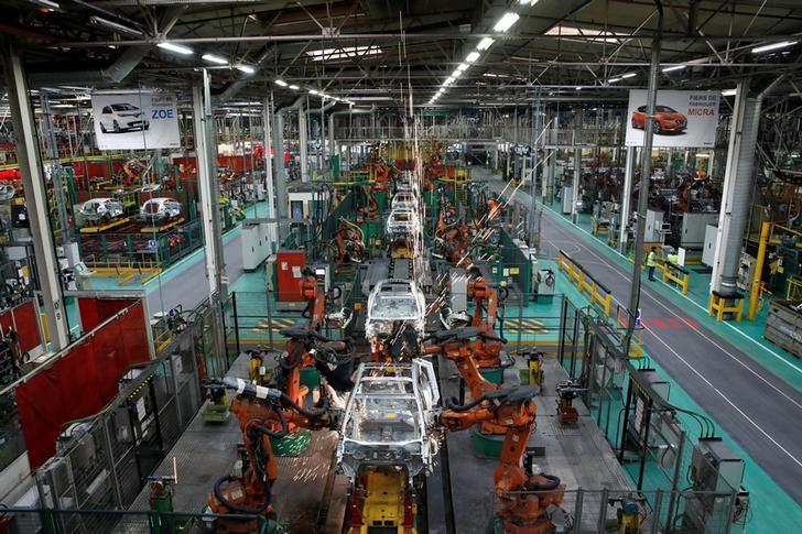 Robots assemble Renault and Nissan automobiles on the production line at the Renault SA car factory in Flins, near Paris, France, February 23, 2017. REUTERS/Benoit Tessier
