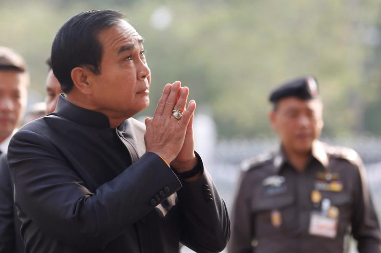 Thailand's Prime Minister Prayuth Chan-ocha gestures in a traditional greeting as he arrives at a weekly cabinet meeting at the Government House in Bangkok, Thailand, March 14, 2017. REUTERS/Chaiwat Subprasom