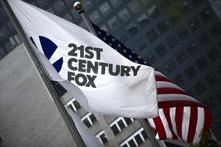 The flag of the Twenty-First Century Fox Inc is seen waving at the company headquarters in the Manhattan borough in New York, New York, U.S. June 11, 2015.   REUTERS/Eduardo Munoz/File Photo