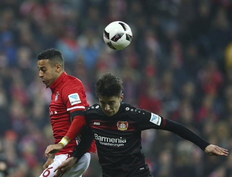 Football Soccer - Bayern Munich v Bayer Leverkusen - German Bundesliga - Allianz-Arena, Munich, Germany - 26/11/16 - Leverkusen's Kai Havertz and Bayern's Thiago Alcantara in action. REUTERS/Michael Dalder
