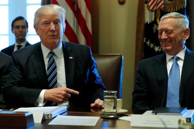U.S. President Donald Trump (L) and Defense Secretary James Mattis (R) holds a cabinet meeting at the White House in Washington, U.S. March 13, 2017. REUTERS/Jonathan Ernst