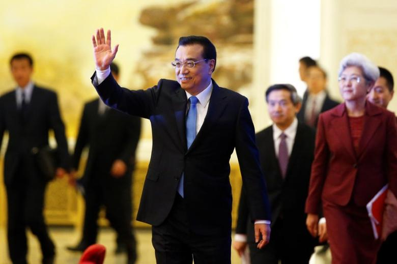 China's Premier Li Keqiang waves as he arrives for a news conference after the closing ceremony of China's National People's Congress (NPC) at the Great Hall of the People in Beijing, China, March 15, 2017. REUTERS/Thomas Peter