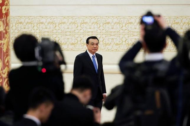 China's Premier Li Keqiang arrives for a news conference after the closing ceremony of China's National People's Congress (NPC) at the Great Hall of the People in Beijing, China, March 15, 2017. REUTERS/Jason lee