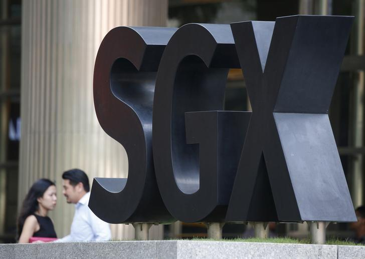 People pass an SGX Singapore Exchange logo outside its premises in Singapore's central business district January 7, 2016.  REUTERS/Edgar Su/File Photo