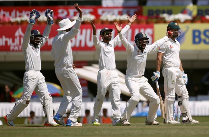 Cricket - India v Australia - Third Test cricket match - Jharkhand State Cricket Association Stadium, Ranchi, India - 16/03/17 - Indian players successfully appeals for the dismissal of Australia's Shaun Marsh (R). REUTERS/Adnan Abidi