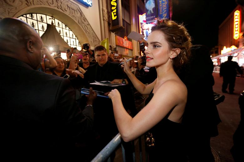 FILE PHOTO: Cast member Emma Watson signs autographs at the premiere of ''Beauty and the Beast'' in Los Angeles, California, U.S. March 2, 2017.   REUTERS/Mario Anzuoni/File Photo